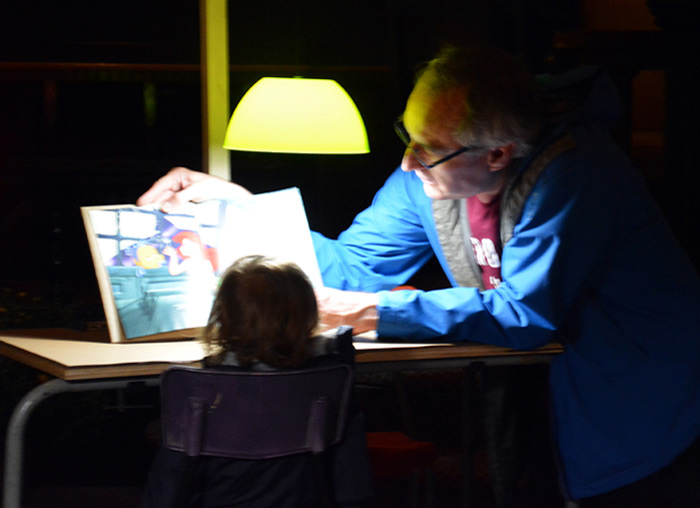 John Shipman, reading aloud a picture book at 100 Libraries, 99 Books - 2016